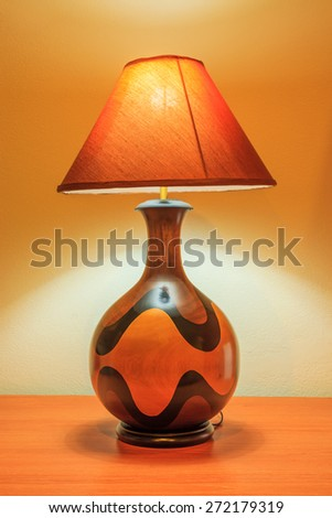 Bedside Lamp stand on a table - stock photo