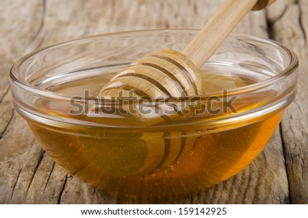 bee honey  in a small glass bowl