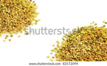 Bee pollen grains isolated on white background. Pollen granules on the corners. - stock photo