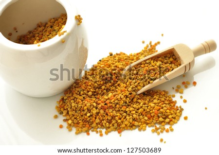bee pollen in the spoon on white - stock photo