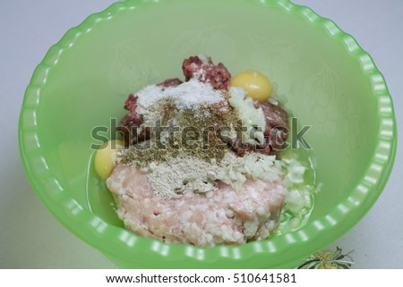 beef and chicken cutlets crude with egg, onions and flour