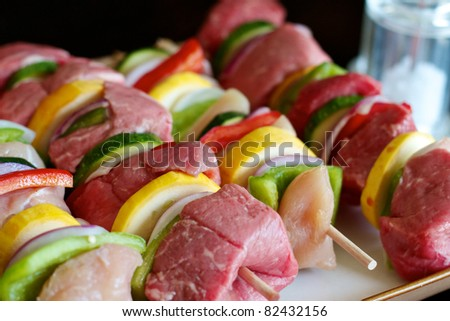Beef and chicken Shish Kabobs ready for the grill - stock photo