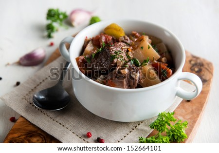 Beef and Golden Beets Stew Garnished with Parsley  - stock photo