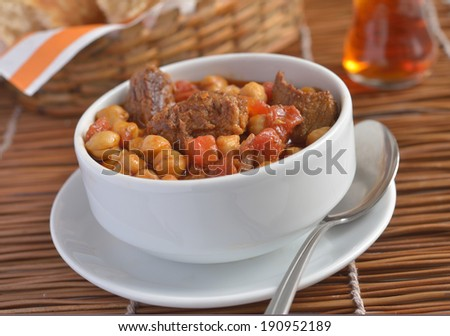 Beef and peanut stew in a bowl