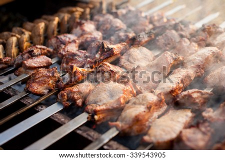 beef and pork steak bbq on the grill