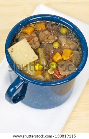 beef and vegetable Soup made with potatoes, carrots, beef, peas, corn, onions, tomatoes, and low sodium beef broth - stock photo