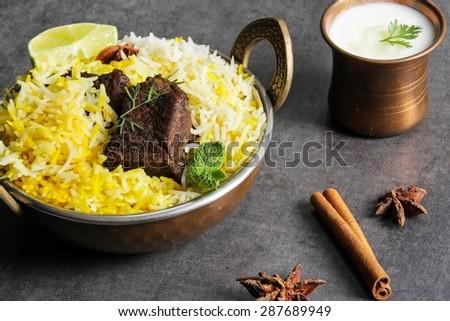 Beef Biryani -Popular Indian and Arabic rice dish with aromatic roasted beef served during Ramadan days - stock photo