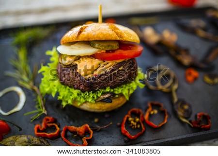 Beef burger - grilled beef tenderloin on a bun - stock photo