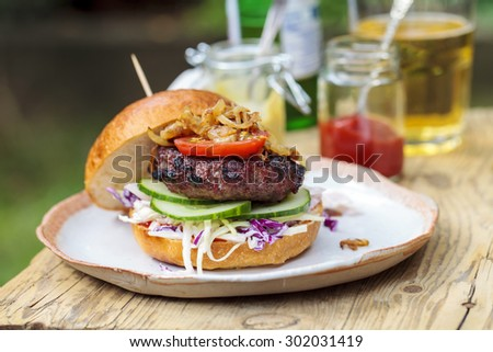 Beef burger in brioche bun - stock photo