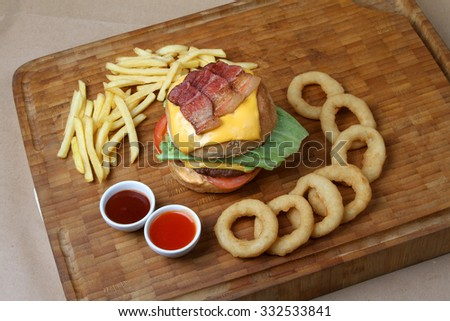 beef burger with grilled bacon  - American food - fast food  - stock photo