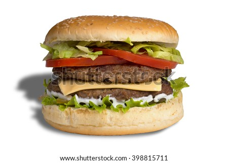 Beef burger with salad in a toasted sesame seeded bun isolated against white