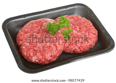 Beef burgers in styrofoam packaging tray - stock photo