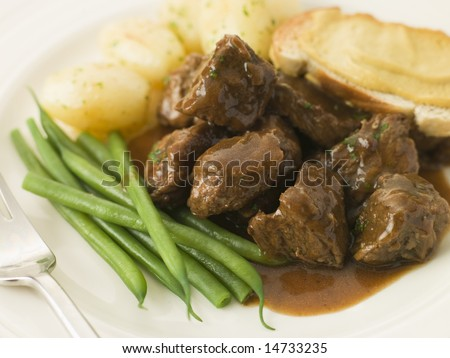 Beef Carbonnade with a Mustard Crouton and Green Beans - stock photo