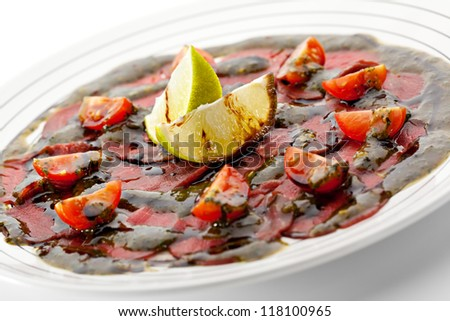 Beef Carpaccio with Tomatoes, Lime and Sauce - stock photo