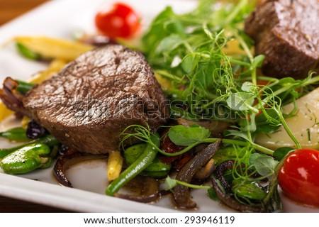 beef cheeks with seasonal salad - stock photo