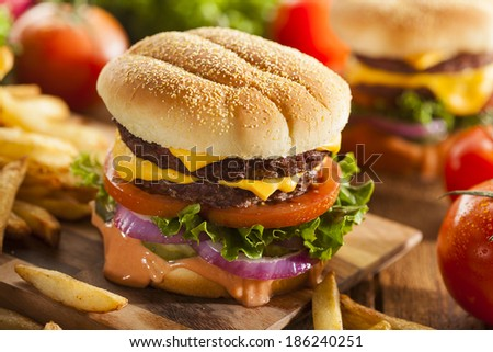 Beef Cheese Hamburger with Lettuce Tomato and Onions - stock photo