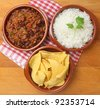 Beef chilli with rice and tortilla chips - stock photo
