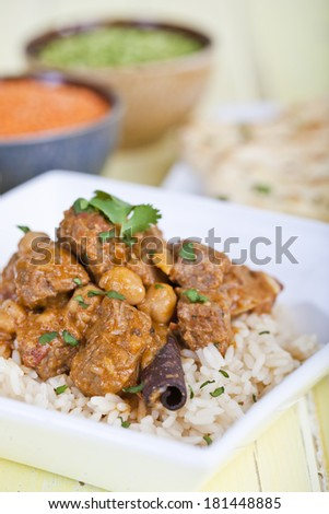 Beef curry served on a bed of rice - stock photo