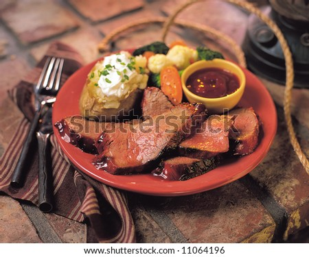 Beef dinner with sides. - stock photo