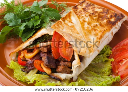 beef fajitas with yellow and red peppers and tomato on plate - stock photo