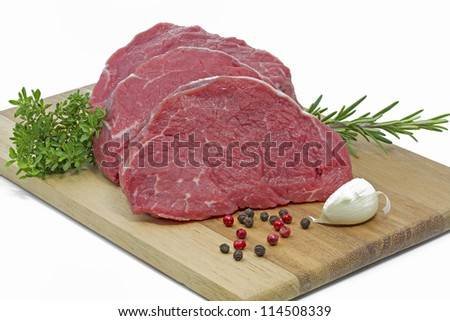 Beef fillet on a chopping board - stock photo