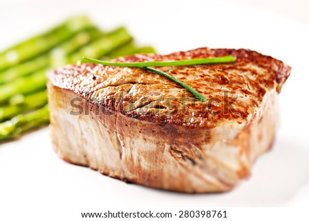 Beef fillet with pink pepper and asparagus. - stock photo