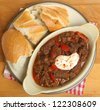 Beef goulash stew with crusty bread - stock photo