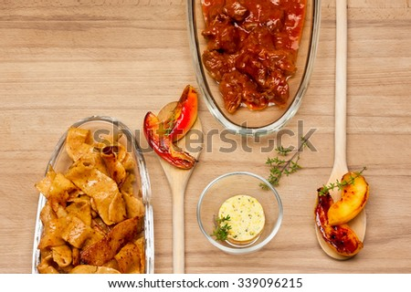 beef goulash with apple and lemon pappardelle noodles with butter - stock photo