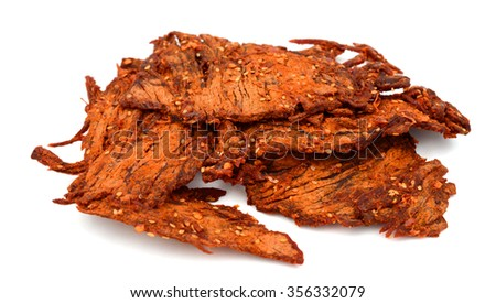 beef jerky with chili pepper flavor on white background