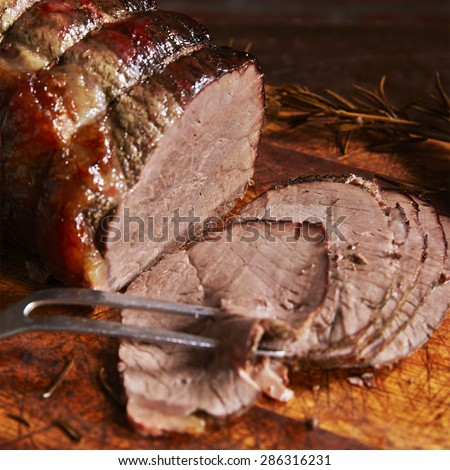 Beef Joint On Board sliced with fork  - stock photo