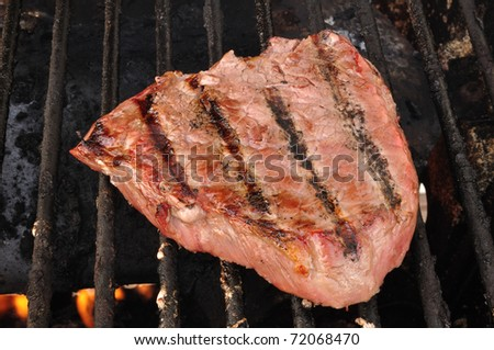 Beef Loin Top Sirloin Steak Cooking on the Grill - stock photo