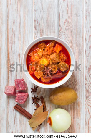 Beef massaman curry, top view on wood background - stock photo