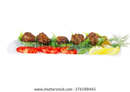 beef meat cutlet with tomatoes on long white plate - stock photo