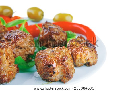 beef meat cutlets served on basil leaf - stock photo