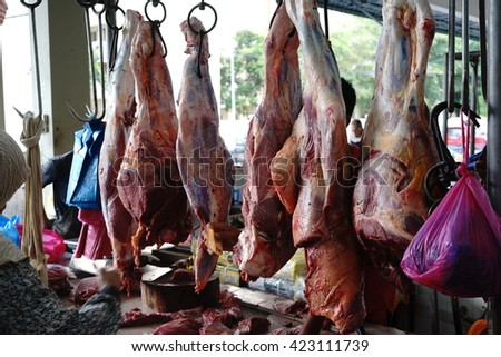beef meat hanging in a butcher shop