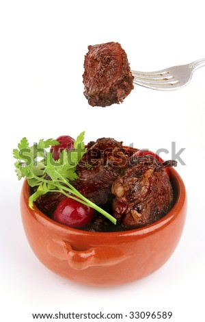 beef meat in pot with vegetables and spices
