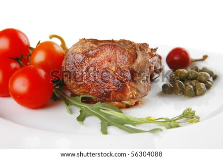 beef meat medallion with  tomatoes on white plate