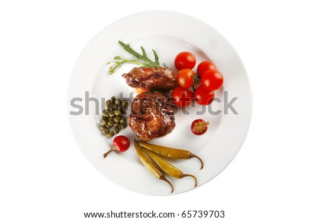 beef meat medallion with  tomatoes on white plate - stock photo