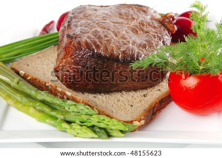 beef meat on bread with asparagus and spices