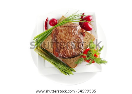 beef meat on bread with asparagus and spices - stock photo