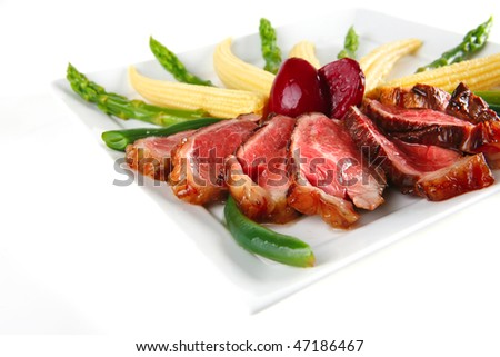 beef meat on white plate with beans and corns