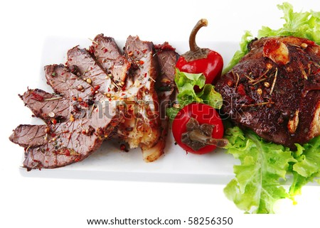 beef meat slices on white ceramic plate - stock photo