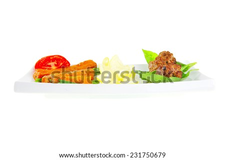 beef meatballs and basil with tomatoes and potatoes - stock photo