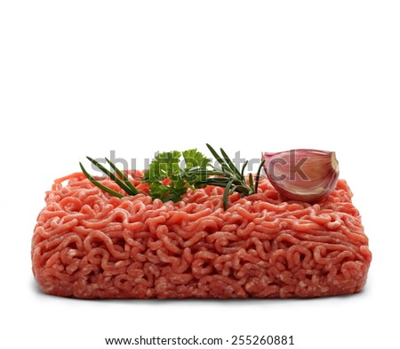Beef minced meat with rosemary, parsley, garlic, isolated - stock photo
