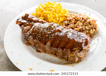 Beef New York Steak with sweet corn and brown rice - stock photo