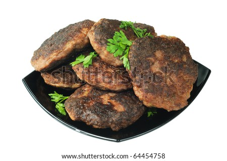 Beef patties on a plate. Isolated on white. - stock photo