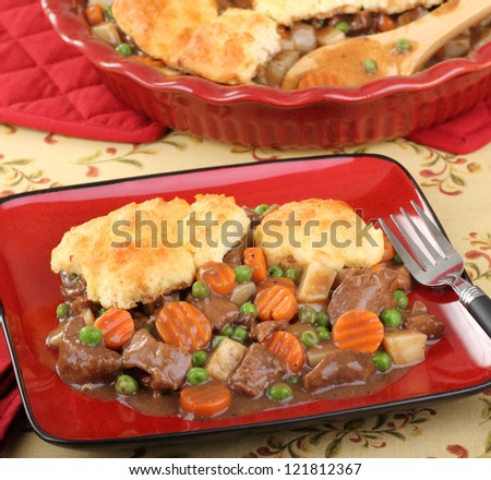Beef pot pie meal with carrots; potatoes; and peas