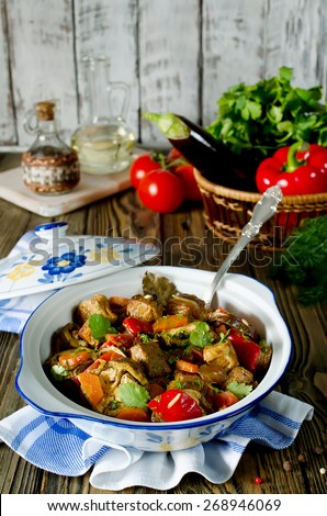 Beef ragout with vegetables. Meat with eggplant, carrots, tomatoes and bell pepper - stock photo