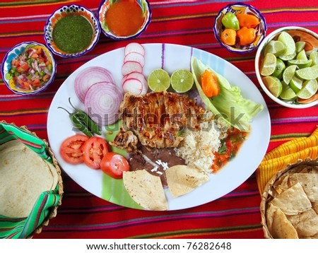 Beef ribs mexican style vegetables chili sauce nachos tortillas - stock photo