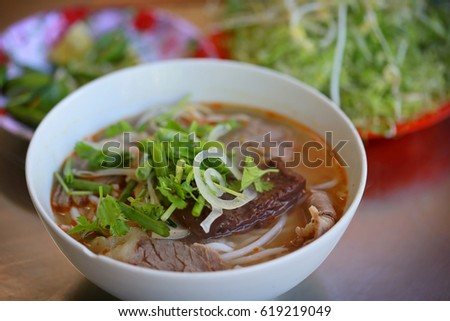 Beef rice noodles (Vietnamese cuisine called Bun Bo): a popular Vietnamese soup containing rice vermicelli and beef